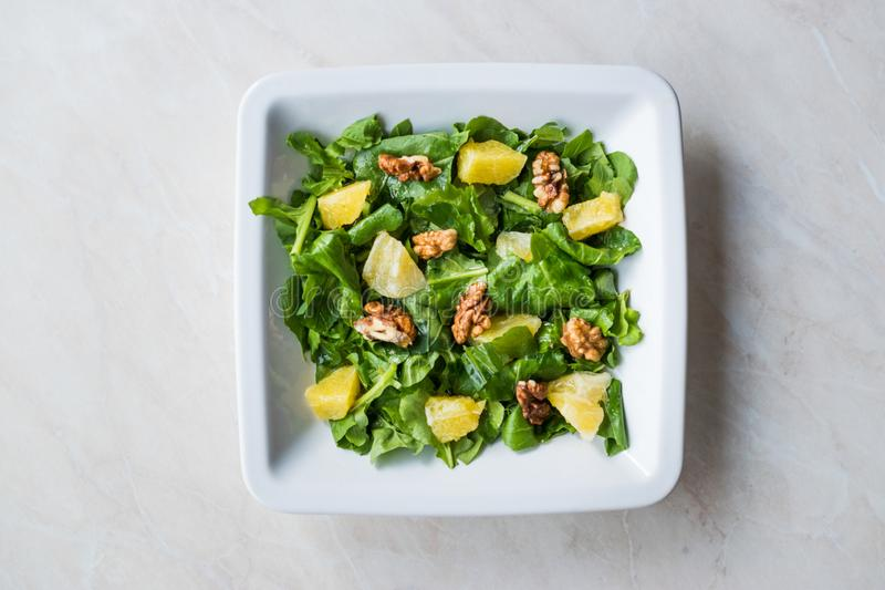 Salad with Rocket Leaves, Orange and Walnuts / Arugula or Rucola. royalty free stock photos