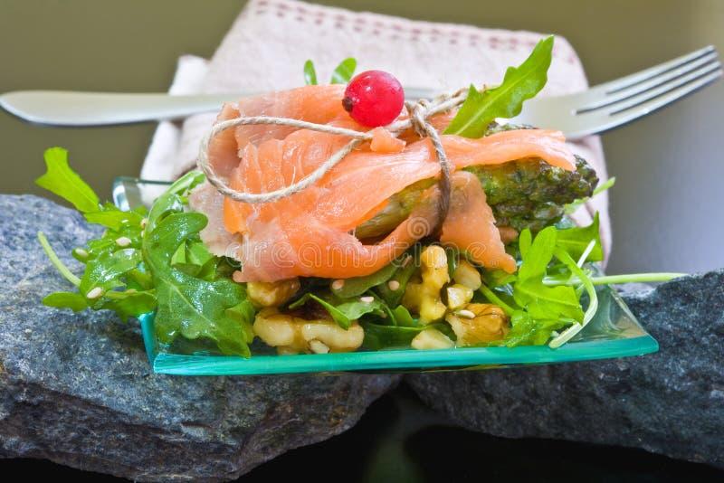 Salad with salmon and asparagu royalty free stock image