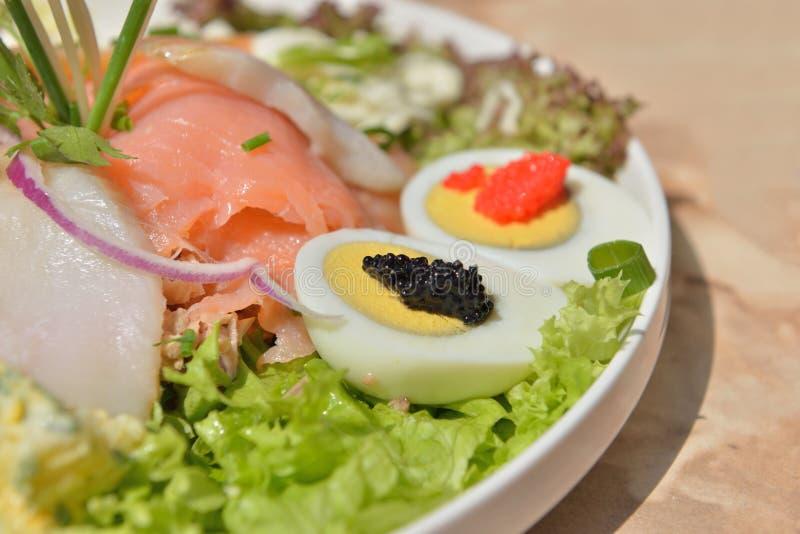 Salad with salmon and caviar stock photos