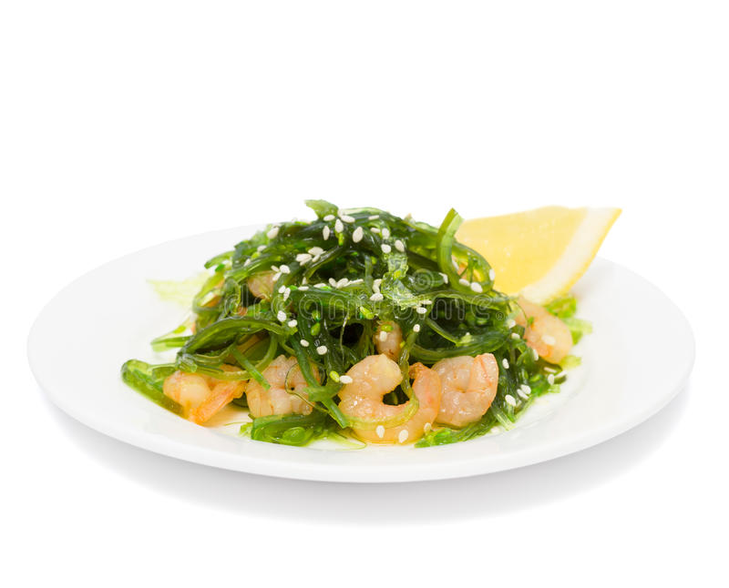 Salad of seaweed chuka with prawns stock image
