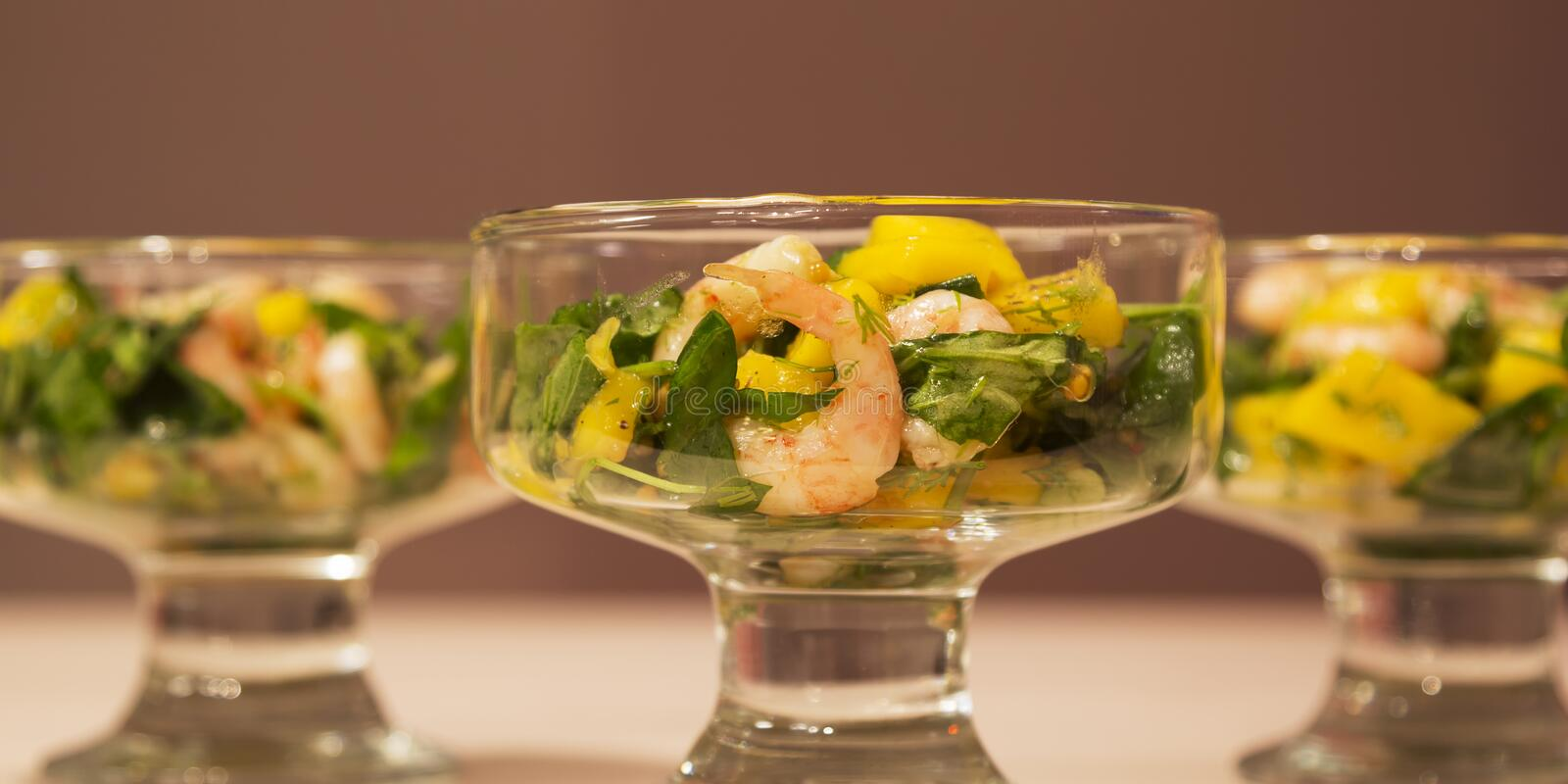 Salad with shrimp, mango and arugula royalty free stock images