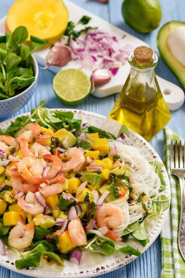 Salad with shrimps, mango, avocado and rice noodles. royalty free stock image