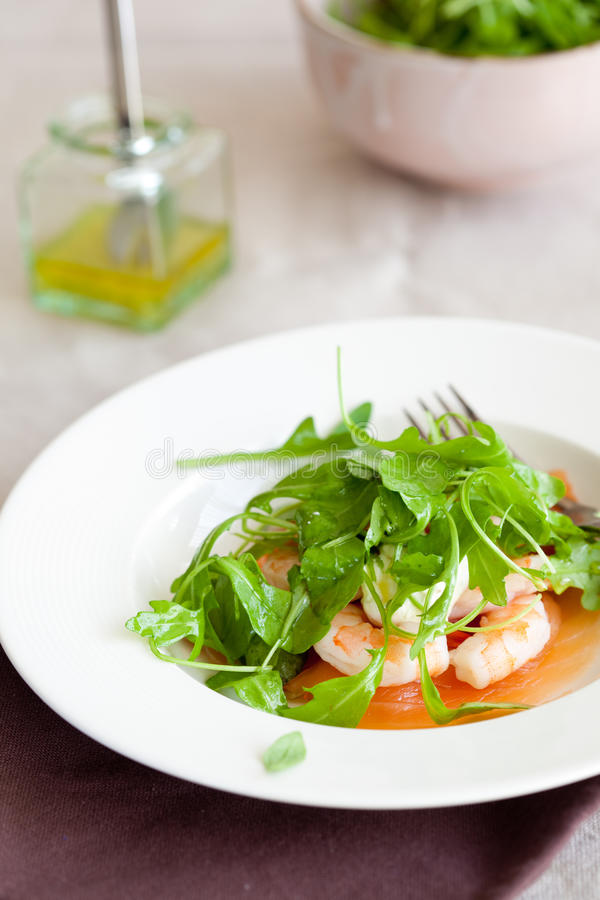Salad with shrimps and salmon royalty free stock photos