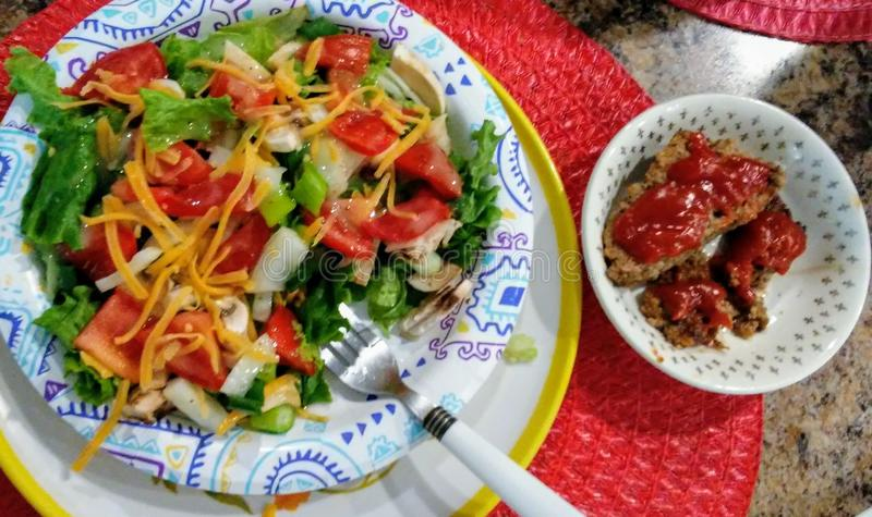 Salad and a side of meatloaf portion control royalty free stock photography