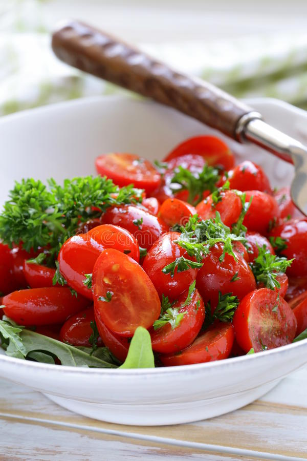 Salad of small cherry tomatoes with parsley stock image