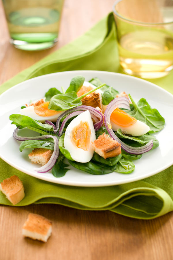 Salad with spinach, eggs stock images