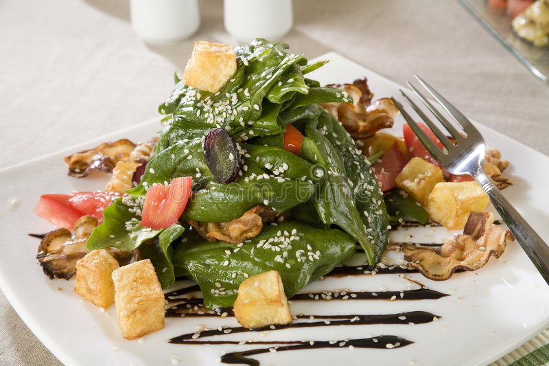 Salad with spinach, grilled ham and potato royalty free stock photo