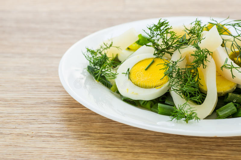 Salad with squid and eggs stock photo