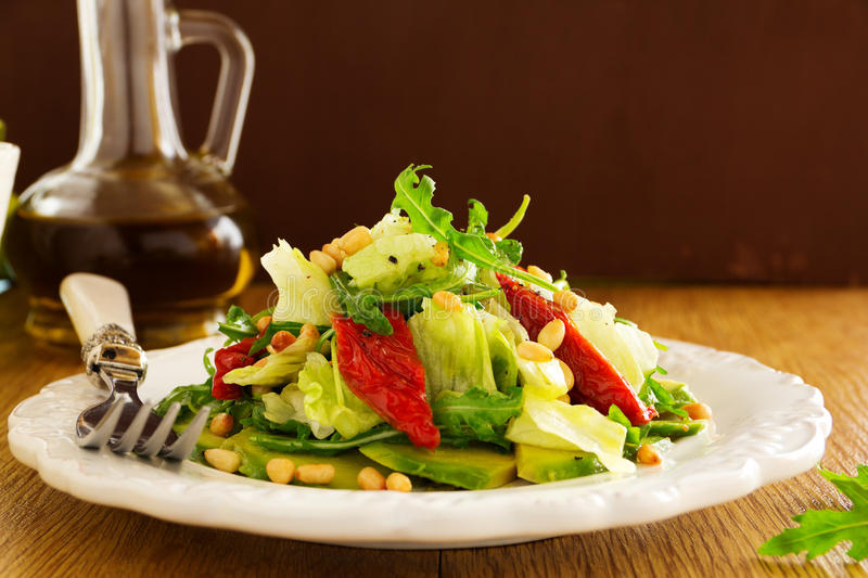 Salad with sun-dried tomatoes. Selective focus royalty free stock images