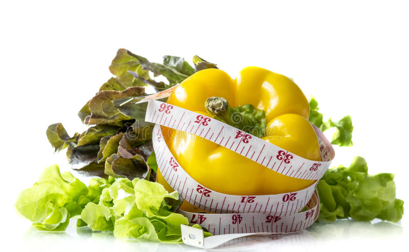 Salad. Sweet pepper and salad with measurement tape , isolated on white background royalty free stock photos