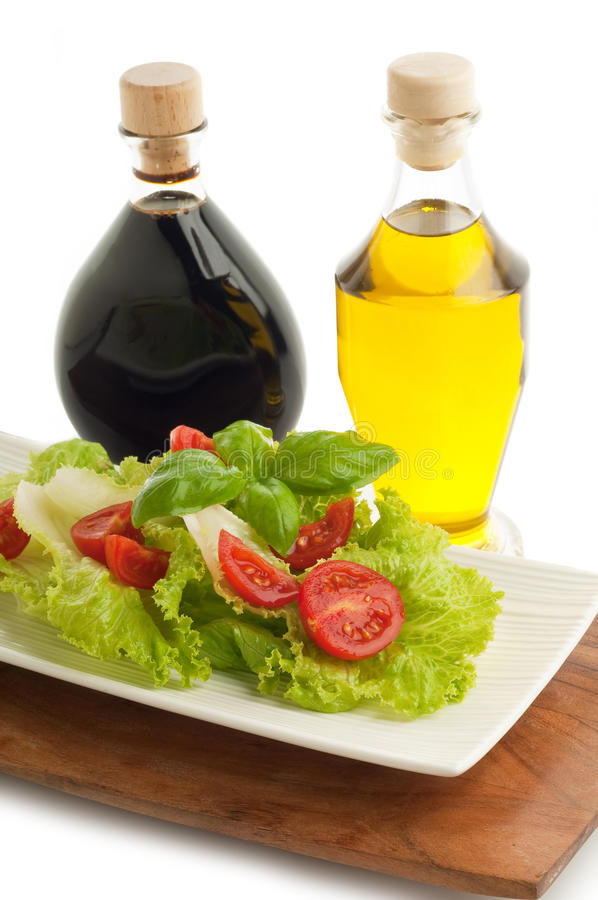 Salad with tomato and basil stock images