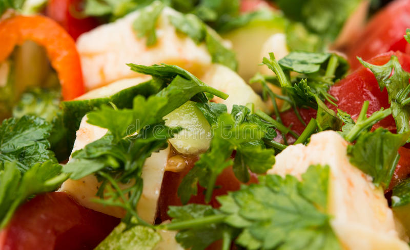 Salad with tomatoes, cucumber and cheese cubes. Fresh salad with tomatoes, cucumber and cheese cubes stock images