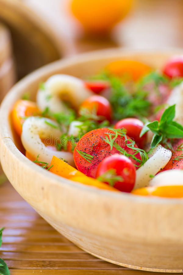 Salad with tomatoes and squid stock photography