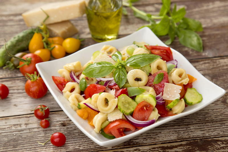 Salad with tortellini pasta. Tomato, Green Pepper and Cucumber stock photos