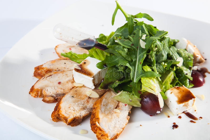 Salad with Turkey and greens stock image