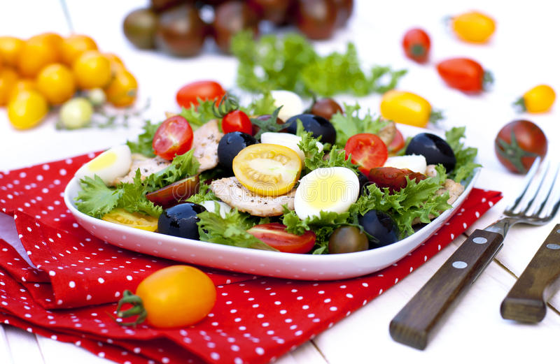 Salad with vegetables and chicken breast stock photos