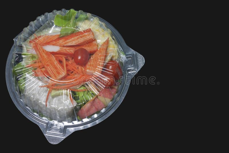Salad vegetables in plastic boxes for sale on black background. stock photo