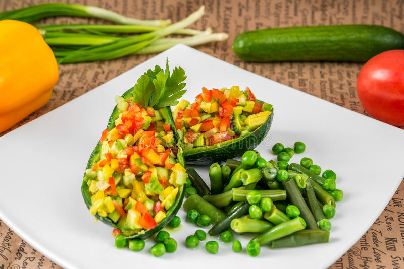 Salad of vegetables, tomatoes, cucumbers, peppers and onions royalty free stock images