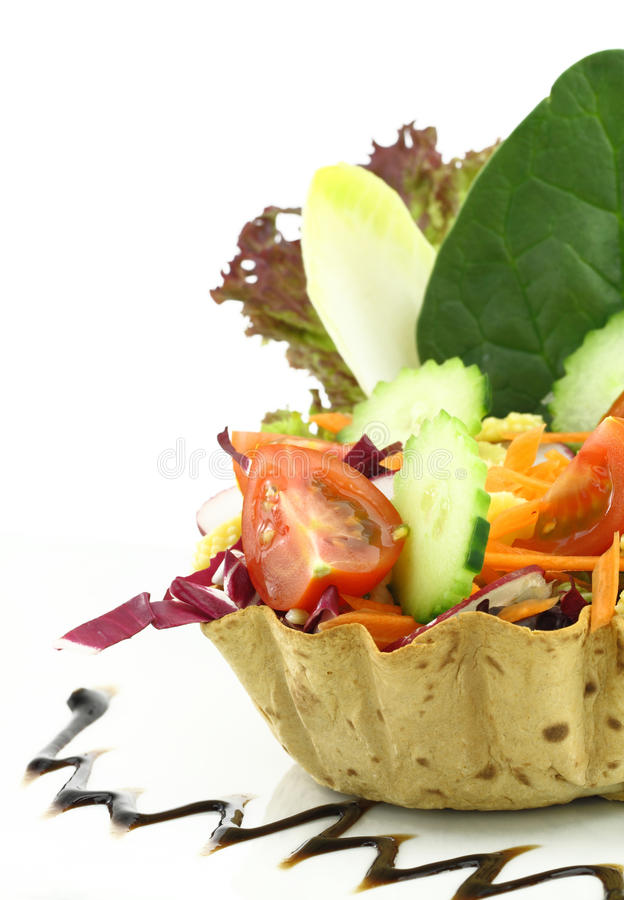 Salad in the waffle. Vegetables salad in the waffle bowl stock images