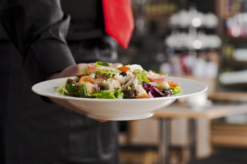 Salad and waiter royalty free stock photography