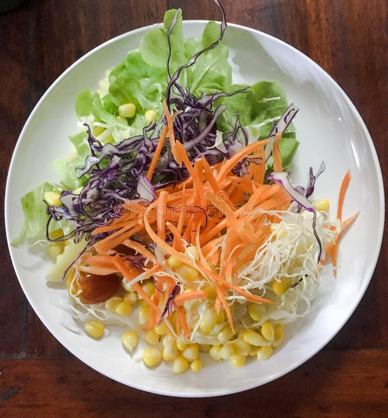 Salad on white plate royalty free stock images