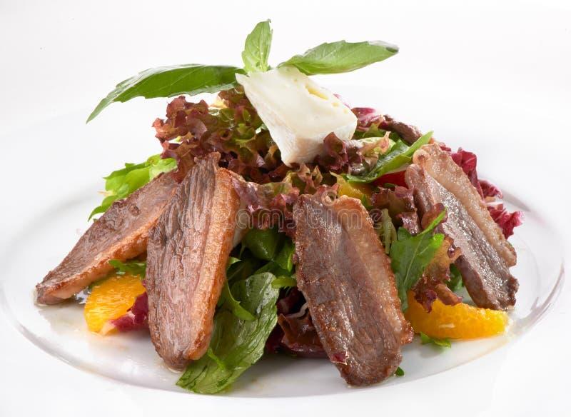 Salada com carne, alface e laranja imagens de stock royalty free