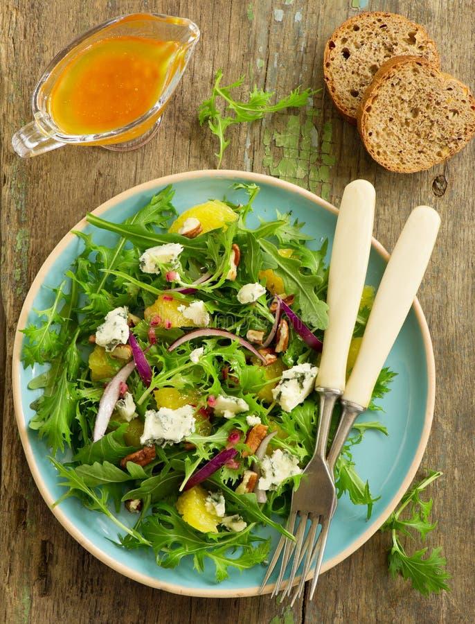 Salada com laranjas, rúcula, imagens de stock