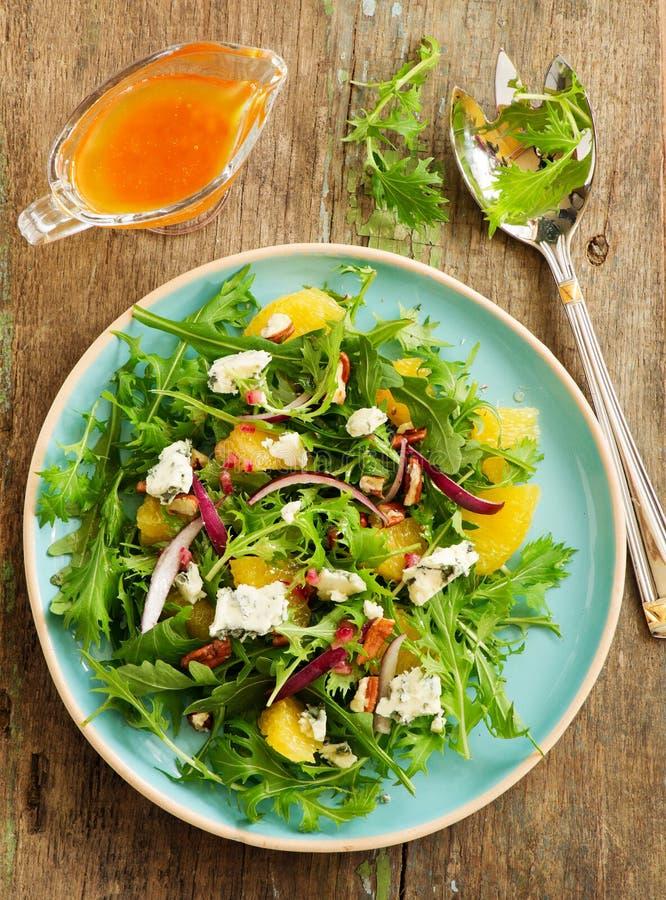 Salada com laranjas, rúcula, fotografia de stock