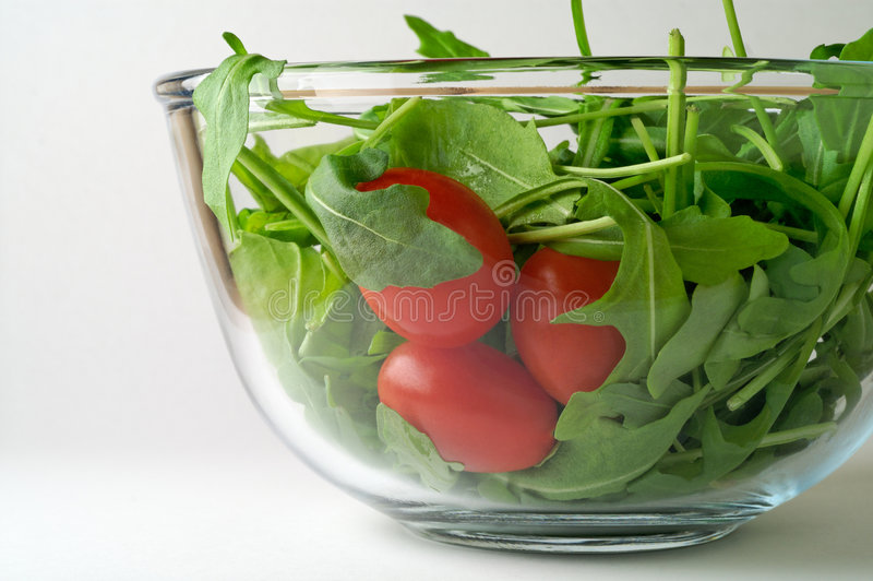 Salada com o tomate do rugola e de cereja fotos de stock