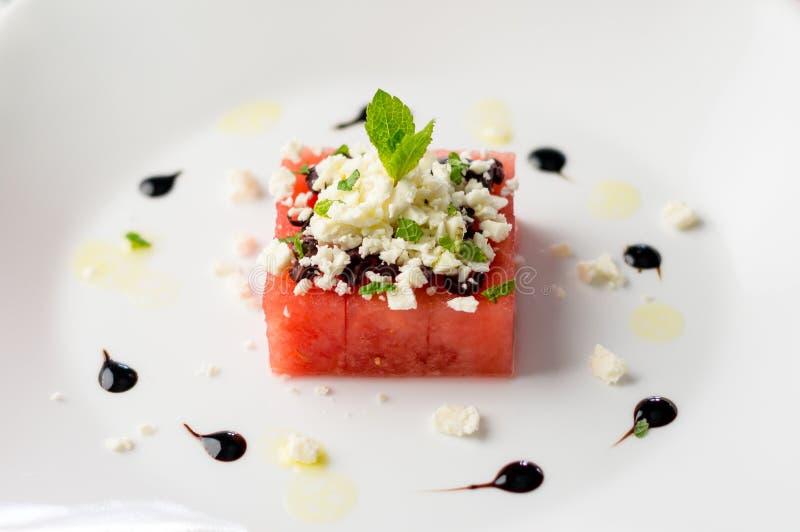 Salada da melancia no branco foto de stock royalty free