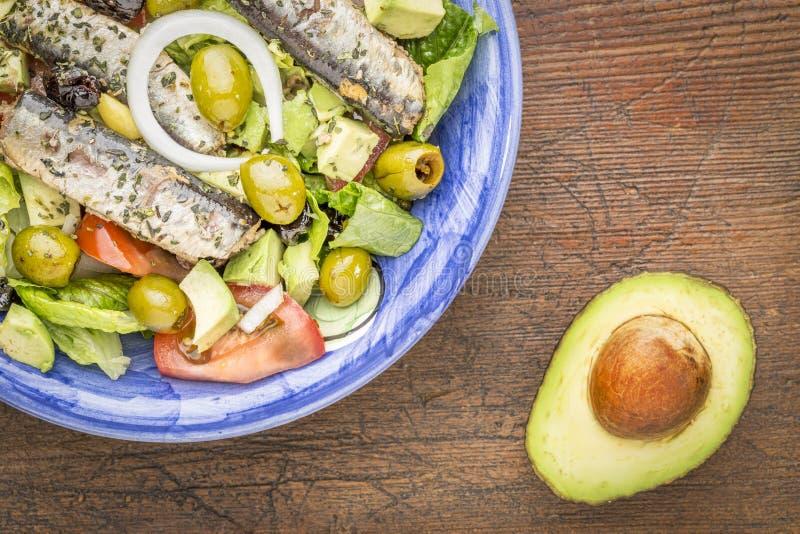 Salada da sardinha com abacate foto de stock royalty free