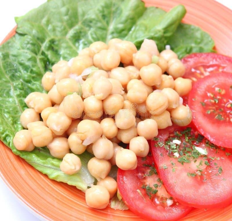 Salada de ervilhas de pintainho imagem de stock