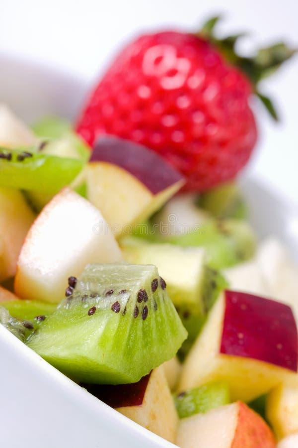 Salada de fruta da dieta na placa branca fotos de stock