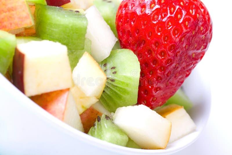 Salada de fruta na placa branca imagem de stock royalty free
