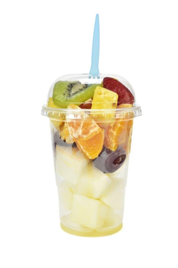 Salada de fruto em um copo plástico fotografia de stock royalty free