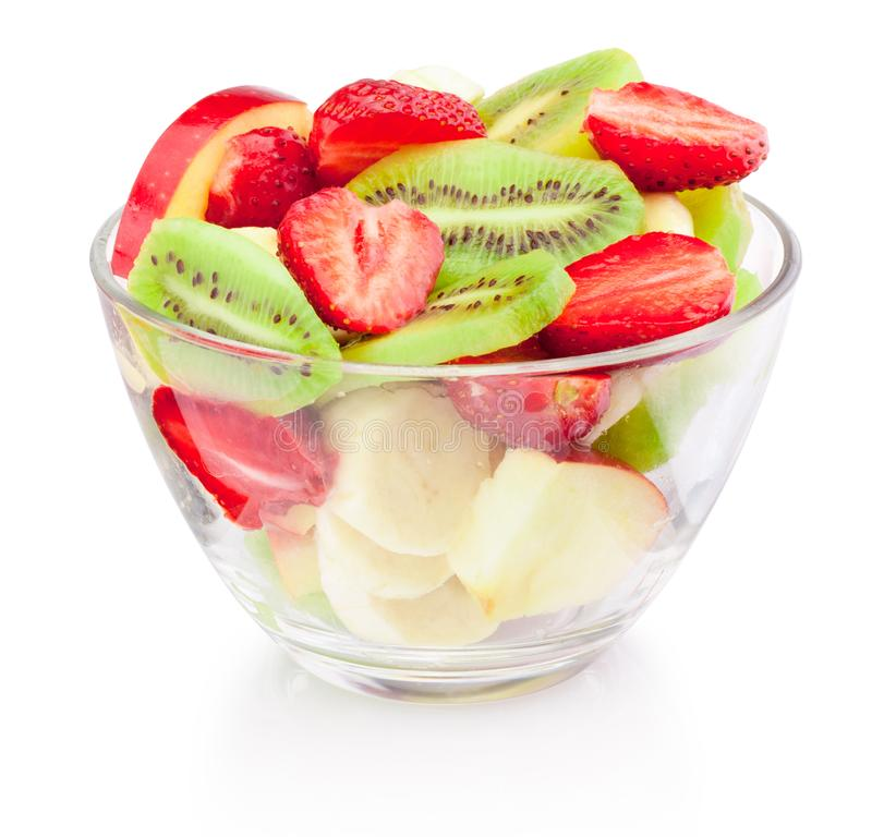 Salada de fruto fresco na bacia de vidro isolada no fundo branco imagem de stock royalty free