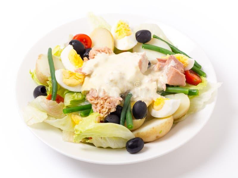 Salada de Nicoise do lado foto de stock