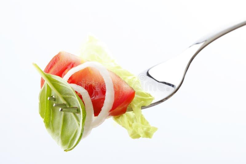 Salada em uma forquilha foto de stock royalty free