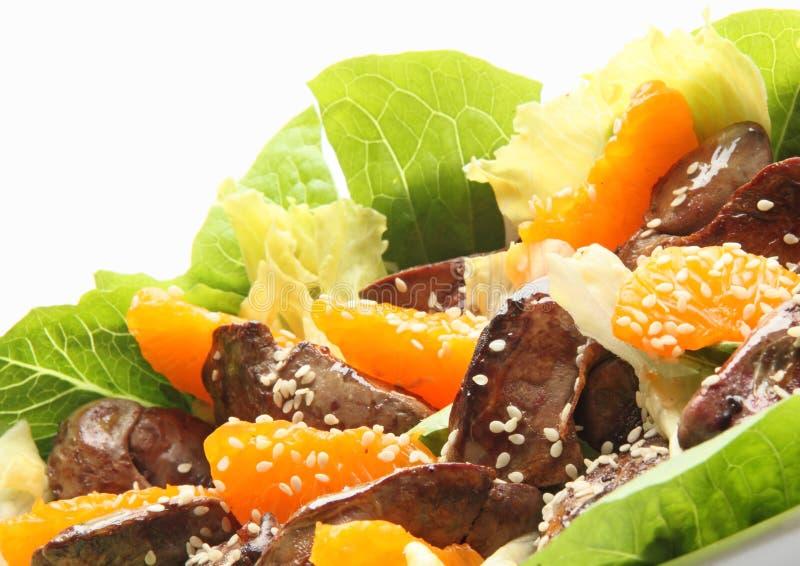 Salada morna com giblets da galinha imagem de stock