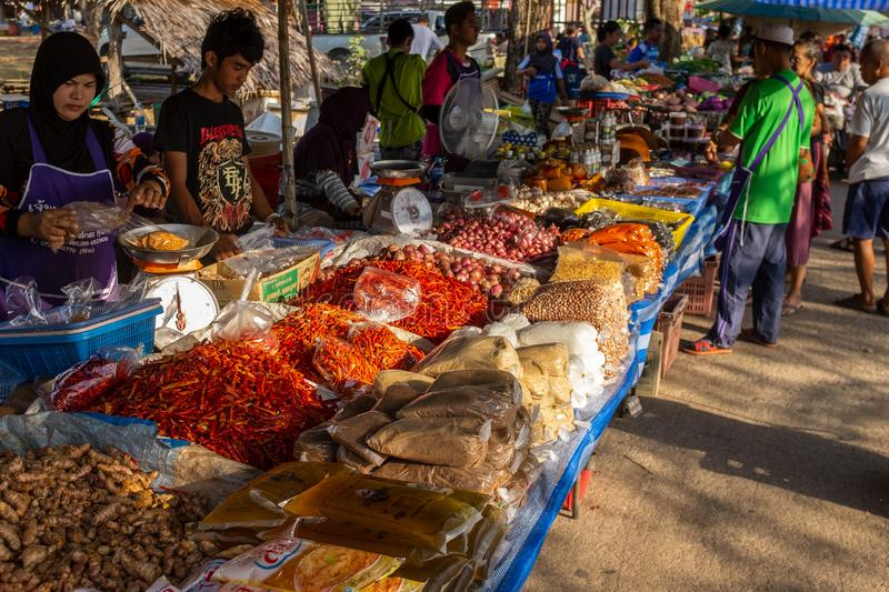 Saladan, Koh Lanta, March, 19, 2018: Gorgeous looking fresh spices on a market stall at a mostly muslim food market on Koh Lanta. Several men and women serving stock photo