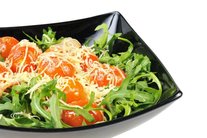 Salade avec l'arugula et les tomates images stock