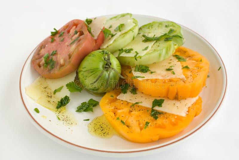 Salade coupée en tranches de tomate d'héritage photos stock