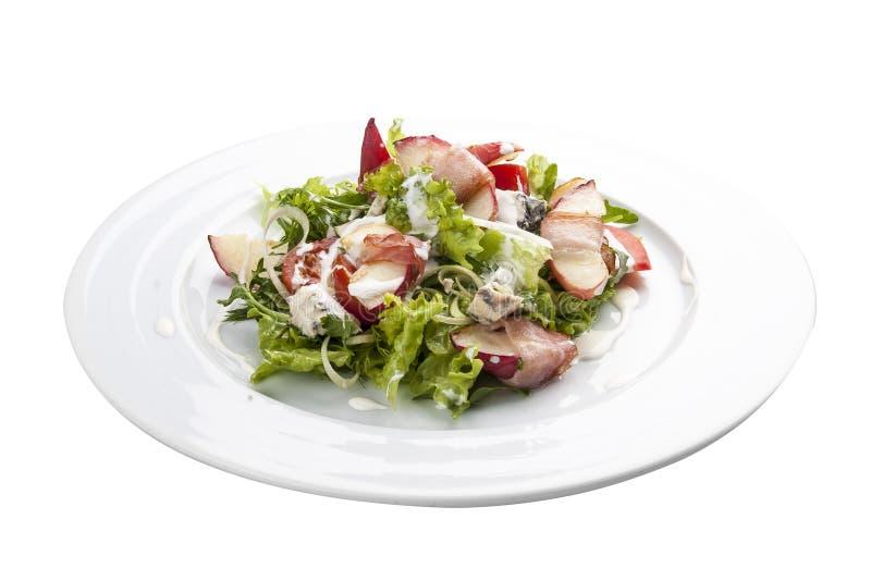 Salade d'été avec la pêche, le lard et l'arugula photographie stock libre de droits