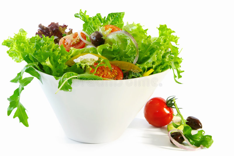 Salade jetée en l'air photo stock