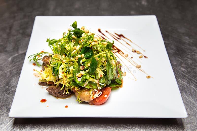 Salade met lever en kruiden royalty-vrije stock afbeeldingen