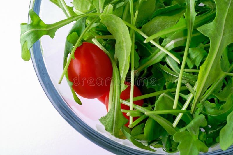 Salade met rugola en kersentomaat royalty-vrije stock afbeelding