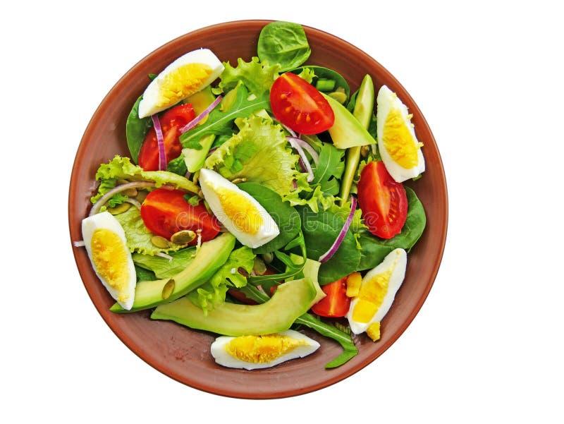Salade verte avec l'arugula, épinards de bébé, avocat d'isolement photos stock
