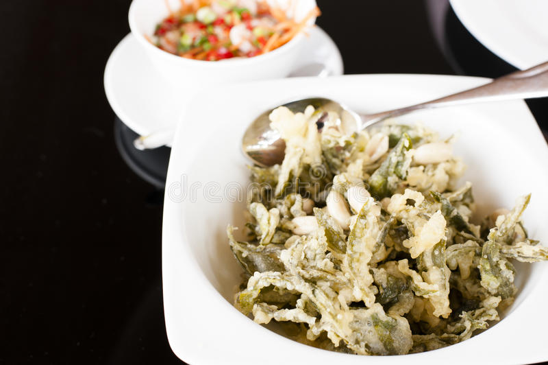 Salade verte de feuilles de thé photos stock