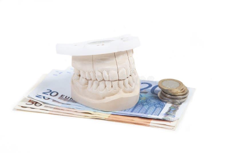 Salaire pour les prothèses dentaires images libres de droits