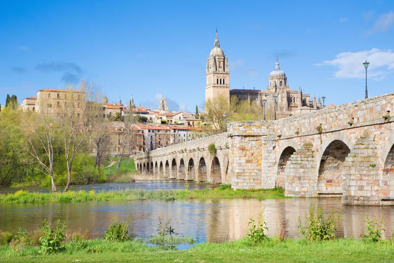 SALAMANCA, SPAIN, 2016: The Cathedral and bridge Puente Romano over the Rio Tormes river. stock images